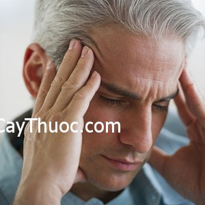Man with a headache --- Image by © Tetra Images/Tetra Images/Corbis
