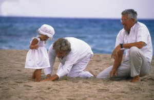 Grandparents with her granddaughter on the shore --- Image by © H.G. Rossi/zefa/Corbis