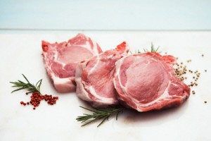 Three raw pork chops --- Image by © John Smith/Corbis