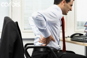 Businessman With Backache --- Image by © Corbis