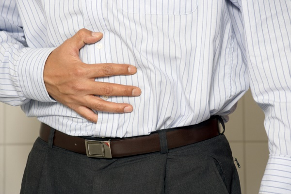 Closeup of a man having stomach pain or indigestion.
